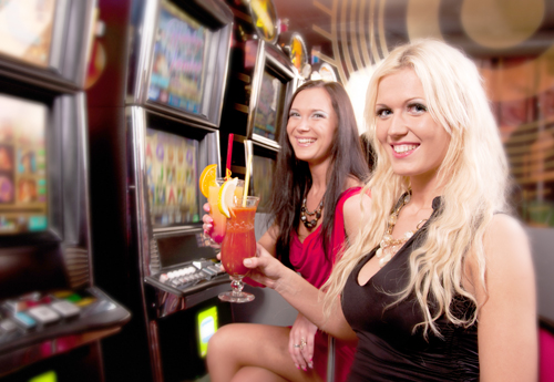 People Playing Slots - shutterstock_175985099 copy